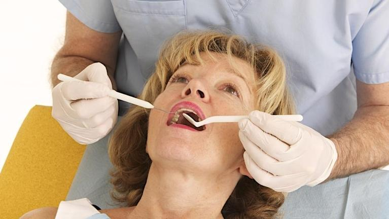 woman during dental exam in annapolis md
