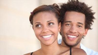 couple with porcelain veneers smiling in annapolis md